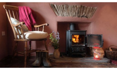 Parlour with wood burner. Photo by Under the Thatch