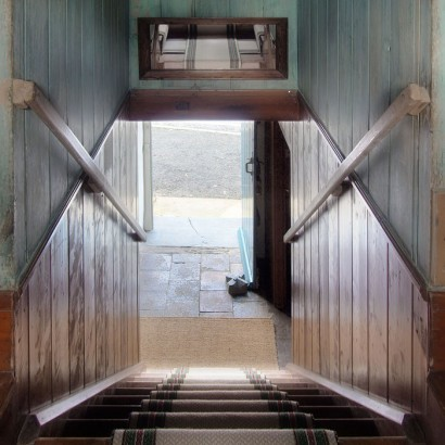 Panelled staircase. Photo by Under the Thatch